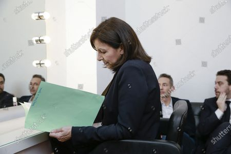 Anne Hidalgo with Patrick Klugman and Ian Brossat (in the background) in her private room during the meeting 'La Planete en Commun'.