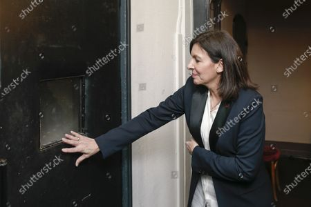 Anne Hidalgo waits at door of Luiz Inacio Lula da Silva, Dilma Rousseff and Fernando Haddad's private room during the meeting 'La Planete en Commun'.