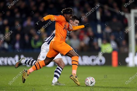 Allan Saint-Maximin of Newcastle United and Gareth Barry of West Bromwich Albion