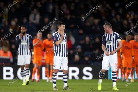Gareth Barry and Chris Brunt of West Bromwich Albion show a look of dejection after conceding the second goal