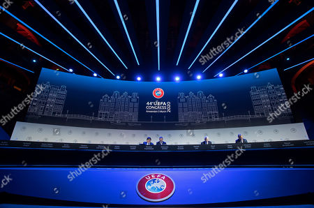 UEFA's Theodore Theodoridis, President Aleskander Ceferin, David Gill, and Zbigniew Boniek, from left, wait for the start of a meeting of European soccer leaders at the congress of the UEFA governing body in Amsterdam's Beurs van Berlage, Netherlands