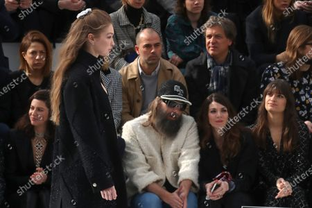 (L-R) French actress Anna Mouglalis, French singer Sebastien Tellier, his wife Amandine de la Richardiere and French singer Clara Luciani sit on front row as US model Gigi Hadid presents a creation from the Fall-Winter 2020/21 Women's collection by French designer Virginie Viard for Chanel fashion house during the Paris Fashion Week, in Paris, France, 03 March 2020. The Fall-Winter 2020/21 women's collection runs from 24 February to 03 March 2020.