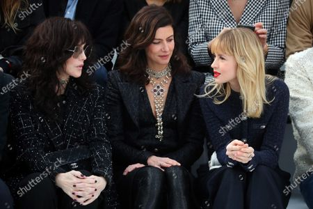 (L-R) French actress Isabelle Adjani, French actress Anna Mouglalis and Belgian singer Angele attend the presentation of the Fall-Winter 2020/21 Women's collection by French designer Virginie Viard for Chanel fashion house during the Paris Fashion Week, in Paris, France, 03 March 2020. The Fall-Winter 2020/21 women's collection runs from 24 February to 03 March 2020.