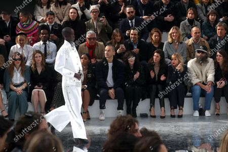 Stock Image of French actress Christa Theret (2-L), US singer Janelle Monae (3-L), French actress Isabelle Adjani (5-R), French actress Anna Mouglalis (4-R), Belgian singer Angele (3-R), French singer Sebastien Tellier (2-R) and his wife Amandine de la Richardiere (R) attend the presentation of the Fall-Winter 2020/21 Women's collection by French designer Virginie Viard for Chanel fashion house during the Paris Fashion Week, in Paris, France, 03 March 2020. The Fall-Winter 2020/21 women's collection runs from 24 February to 03 March 2020.