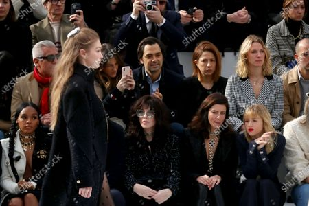 (L-R) US singer Janelle Monae, French actress Isabelle Adjani and French actress Anna Mouglalis sit on front row as US model Gigi Hadid presents a creation from the Fall-Winter 2020/21 Women's collection by French designer Virginie Viard for Chanel fashion house during the Paris Fashion Week, in Paris, France, 03 March 2020. The Fall-Winter 2020/21 women's collection runs from 24 February to 03 March 2020.