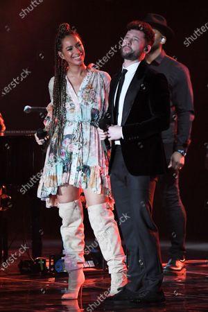 Leona Lewis and Calum Scott performing a duet.