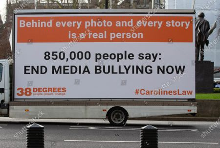Caroline's Law advertising vans in Parliament Square. 
