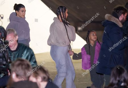 Kourtney Kardashian, Kim Kardashian West (C) and North West