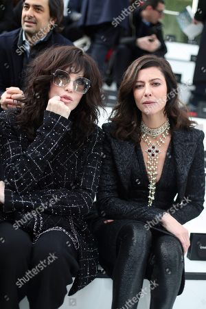 Actresses Isabelle Adjani, left, and Anna Mouglalis attend Chanel fashion collection during Women's fashion week Fall/Winter 2020/21 presented in Paris