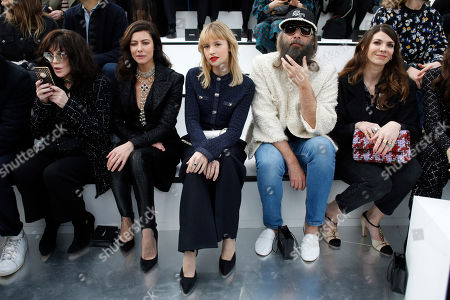 From left, actresses Isabelle Asjani, Anna Mouglalis, singer Angele, Sebastien Tellier and Amandine de la Richardiere pose for photographers prior to the Chanel fashion collection during Women's fashion week Fall/Winter 2020/21 presented in Paris