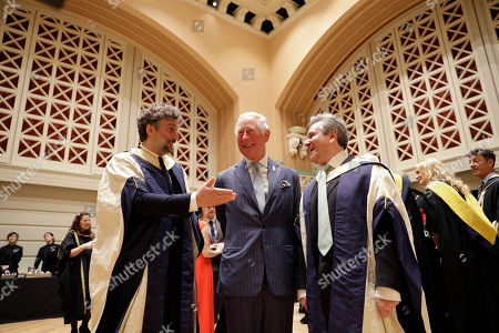 Britain's Prince Charles poses for photographs with German operatic tenor Jonas Kaufmann, left, and English-Italian conductor and pianist Sir Antonio Pappano during a reception in the new Performance Hall, after presenting them with honorary Doctor of Music awards at the Royal College of Music's annual awards in London