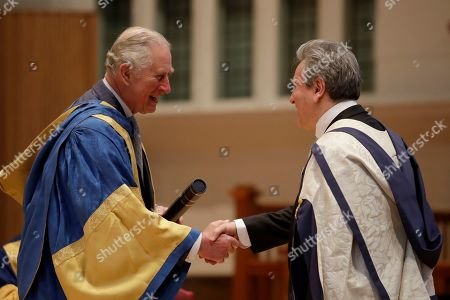 Britain's Prince Charles shakes hands as he presents English-Italian conductor and pianist Sir Antonio Pappano with an honorary Doctor of Music award at the Royal College of Music's annual awards in London