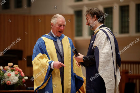 Britain's Prince Charles presents German operatic tenor Jonas Kaufmann with an honorary Doctor of Music award at the Royal College of Music's annual awards in London