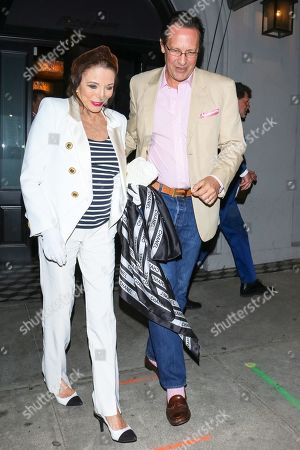 Joan Collins and Percy Gibson outside Craig's Restaurant