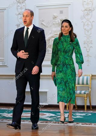 Britain's Prince William (L) and his wife Catherine Duchess of Cambridge (R), meet with Ireland's President Michael D. Higgins and his wife Sabina (both unseen) at the official presidential residence Aras an Uachtarain in Dublin, Ireland