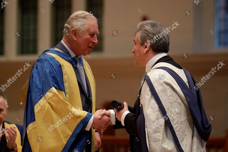 Britain's Prince Charles presents English-Italian conductor and pianist Sir Antonio Pappano with an honorary Doctor of Music award at the Royal College of Music's annual awards.