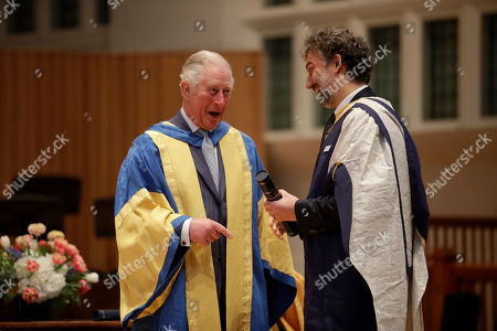 Britain's Prince Charles presents German operatic tenor Jonas Kaufmann with an honorary Doctor of Music award at the Royal College of Music's annual awards.