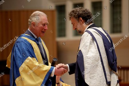 Britain's Prince Charles shakes hands as he presents German operatic tenor Jonas Kaufmann with an honorary Doctor of Music award at the Royal College of Music's annual awards.