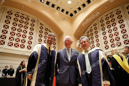 Britain's Prince Charles poses for photographs with German operatic tenor Jonas Kaufmann, left, and English-Italian conductor and pianist Sir Antonio Pappano during a reception in the new Performance Hall, after presenting them with honorary Doctor of Music awards at the Royal College of Music's annual awards.