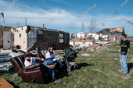 Will Green (L) sits amid the debris of a house where he lives with his father, that was damaged when a tornado struck Nashville, Tennessee, USA, 03 March 2020. His friends, Matthew and Stephanie Lowe and their 6-month-old daughter Daylee were there to help with the clean up. The tornado that moved across Middle Tennessee left at least 21 dead.