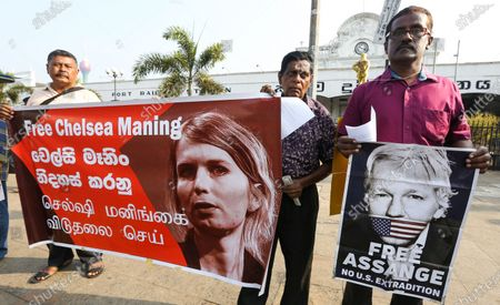 Members of Sri Lanka's Socialist Equality Party hold placards during a protest in Colombo, Sri Lanka, 03 March 2020. Members of Sri Lanka's Socialist Equality Party (SEP) staged a protest in front of the Colombo fort main railway station demanding the immediate and unconditional release of American whistleblower Chelsea Manning and Wikileaks founder Julian Assange.