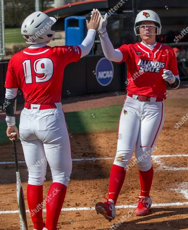 Illinois State's Anni Borries, left, gives Alyssa Wiebel a high five as Wiebel crosses home plate, scoring a run on the way to Illinois State's 5-0 victory over Indiana University-Purdue University Indianapolis in a Hilltopper Spring Fling tournament NCAA softball game, in Bowling Green, KY