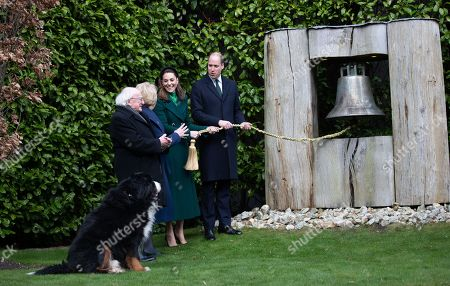 President of Ireland Michael D. Higgins and his wife Sabina Coyne watch as Catherine Duchess of Cambridge and Prince William ring the Peach Bell during a meeting