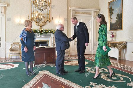 Prince William and Catherine Duchess of Cambridge are greeted by the President of Ireland Michael D. Higgins and his wife Sabina Coyne