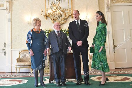 (L-R) Sabina Coyne, President of Ireland Michael D. Higgins, Prince William and Catherine Duchess of Cambridge pose during a meeting