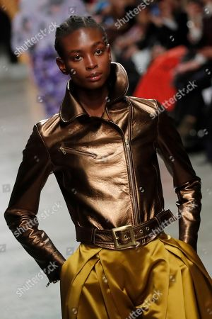 Stock Photo of A model wears a creation for Junko Shimada fashion collection during Women's fashion week Fall/Winter 2020/21 presented in Paris