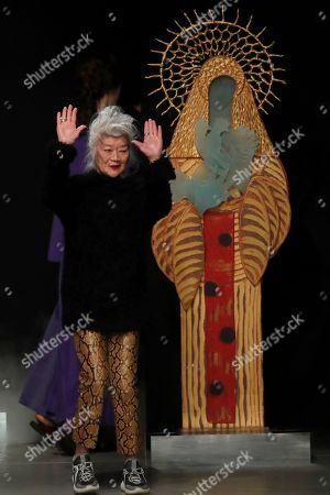 Designer Junko Shimada accepts applause at the conclusion of the Junko Shimada fashion collection during Women's fashion week Fall/Winter 2020/21 presented in Paris
