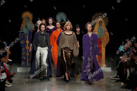 Models wear creations for Junko Shimada fashion collection during Women's fashion week Fall/Winter 2020/21 presented in Paris