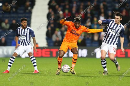 Newcastle United midfielder Allan Saint-Maximin, West Bromwich Albion midfielder Gareth Barry and West Bromwich Albion defender Darnell Furlong compete for the ball during the The FA Cup match between West Bromwich Albion and Newcastle United at The Hawthorns, West Bromwich