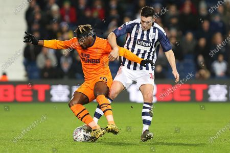 Newcastle United midfielder Allan Saint-Maximin and West Bromwich Albion midfielder Gareth Barry compete for the ball during the The FA Cup match between West Bromwich Albion and Newcastle United at The Hawthorns, West Bromwich