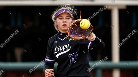 Stock Image of Lipsombs Olivia Ward catches the ball during an NCAA softball game against SIU Edwardsville, in Nashville, Tenn