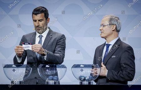 Former Portuguese soccer player Luis Figo (L), next to UEFA Deputy General Secretary Giorgio Marchetti, shows the lot of Belgium during the UEFA Nations League 2020-21 Draw for the League A in Amsterdam, The Netherlands, 03 March 2020.