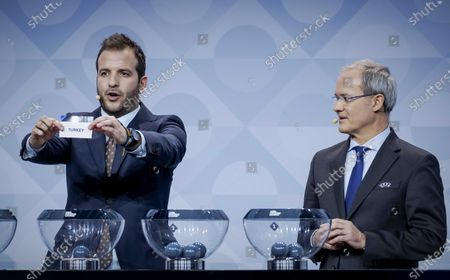 Former Dutch player Rafael van der Vaart (L), next to UEFA Deputy General Secretary Giorgio Marchetti, shows the lot of Turkey during the UEFA Nations League 2020-21 Draw for the League A in Amsterdam, The Netherlands, 03 March 2020.