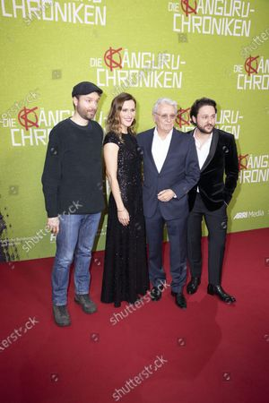 Stock Image of Creator and screenwriter Marc-Uwe Kling ,German actress and cast member Bettina Lamprecht, German actor and cast member Henry Huebchen, Actor and cast member Dimitrij Schaad pose for photographers on the red carpet during the world premiere of the movie Die Kaenguru-Chroniken (lit. The Kangaroo Chronicles) at the ZOO Palast in Berlin, Germany, 03 March, 2020. The comedy film is based on the books and audio-books by Marc-Uwe Kling, and will be played in theaters from 05 March 2020.
