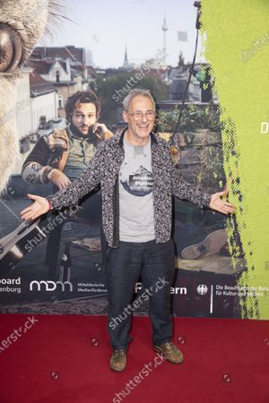 Stock Picture of Dani Levy poses for photographers on the red carpet during the world premiere of the movie Die Kaenguru-Chroniken (lit. The Kangaroo Chronicles) at the ZOO Palast in Berlin, Germany, 03 March, 2020. The comedy film is based on the books and audio-books by Marc-Uwe Kling, and will be played in theaters from 05 March 2020.