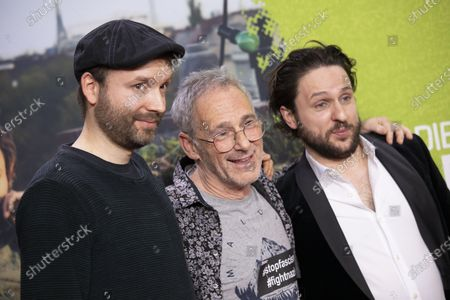 Stock Image of Creator and screenwriter Marc-Uwe Kling, Swiss director Dani Levy, Actor and cast member Dimitrij Schaad, pose  for photographers on the red carpet during the world premiere of the movie Die Kaenguru-Chroniken (lit. The Kangaroo Chronicles) at the ZOO Palast in Berlin, Germany, 03 March, 2020. The comedy film is based on the books and audio-books by Marc-Uwe Kling, and will be played in theaters from 05 March 2020.