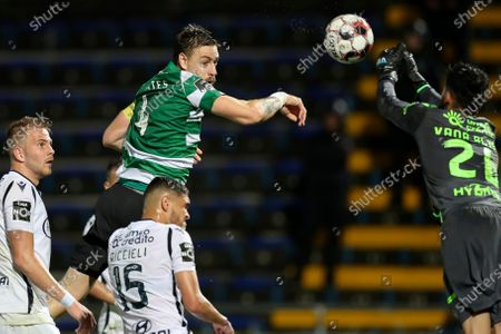 Famalicao's goalkeeper Vana (R) in action against Sporting's Sebastian Coates (2-L) during their Portuguese First League soccer match held at 22 June Municipal stadium, in Famalicao, Portugal, 03 March 2020.