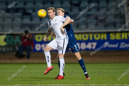 Stock Photo of Robert Thomson of Alloa Athletic challenges for the ball with Christophe Berra of Dundee