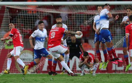 Paolo Guerrero of Brazil's Internacional, 3rd right, scores his side's opening goal against Chile's Universidad Catolica during a Copa Libertadores soccer match in Porto Alegre, Brazil