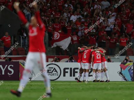 Soccer players of Brazil's Internacional celebrate the second goal scored by Paolo Guerrero against Chile's Universidad Catolica during a Copa Libertadores soccer match in Porto Alegre, Brazil