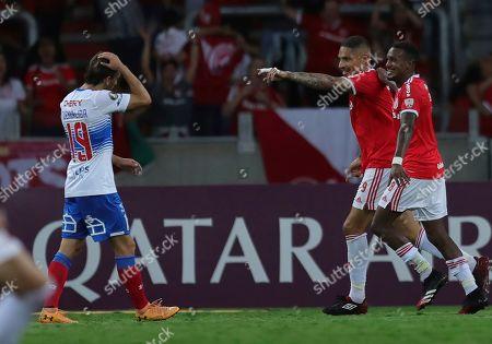 Paolo Guerrero of Brazil's Internacional, 2nd right, celebrates scoring his side's second goal against Chile's Universidad Catolica during a Copa Libertadores soccer match in Porto Alegre, Brazil