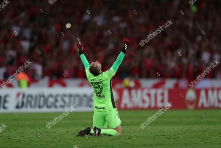 Goalkeeper Marcelo Lomba of Brazil's Internacional celebrates the opening goal scored by Paolo Guerrero against Chile's Universidad Catolica during a Copa Libertadores soccer match in Porto Alegre, Brazil