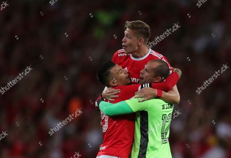 Goalkeeper Marcelo Lomba of Brazil's Internacional, right, celebrates with teammates the opening goal scored by Paolo Guerrero against Chile's Universidad Catolica during a Copa Libertadores soccer match in Porto Alegre, Brazil