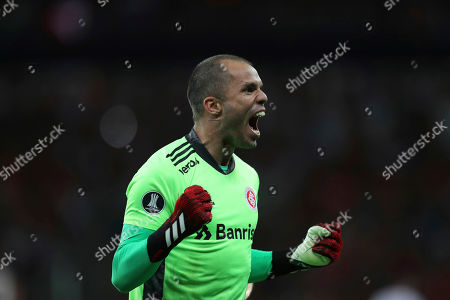 Goalkeeper Marcelo Lomba of Brazil's Internacional celebrates the second goal scored by Paolo Guerrero against Chile's Universidad Catolica during a Copa Libertadores soccer match in Porto Alegre, Brazil, . Brazil's Internacional won 3-0