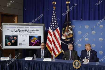 United States President Donald Trump participates in a coronavirus roundtable briefing at National Institutes of Health's Vaccine Research Center in Bethesda, Maryland. From left to right: Dr. John Mascola, Director, Vaccine Research Center, NIH; Director of the National Institute of Allergy and Infectious Diseases at the National Institutes of Health Dr. Anthony Fauci; and the President.