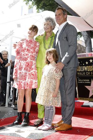 Stock Photo of US radio host Susan Stamberg, her son US actor Josh Stamberg and his daughters Vivian (L) and Lena (front) at a ceremony honoring Susan Stamberg with the 2690th star on the Hollywood Walk of Fame in Los Angeles, California, USA, 24 February 2020. The star is dedicated in the category of Radio.